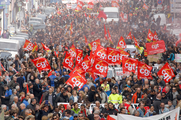 Employees, workers and students demonstrate in Marseille, southern France, Thursday, March 31, 2016. Student organizations and employee unions have joined to call for protests across France to reject a government reform relaxing the 35-hour workweek and other labor rules, which they consider as badly damaging hard-fought worker protections. (AP Photo/Claude Paris)